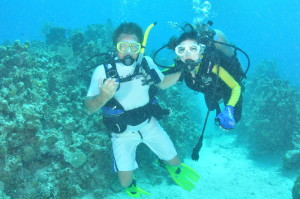 Cody testing out the effects of scuba diving on paraplegics with an instructor.